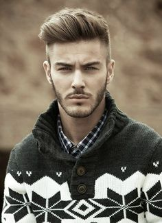 Gorgeous half shaved voluminous hairstyle for men