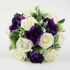 Purple lisianthus and white rose bouquet