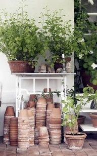country potting bench | Love all the worn pots!