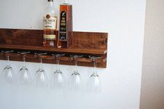 Our rustic wood wine rack shelf & stemware glass holder is carefully crafted from solid wood construction and highlights the wood grain beautifully. The wine rack shelf is perfect for bottles, additional glassware, plants, pictures, etc. • Made from 100% solid rough sawn, high grain,