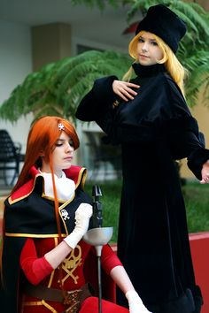 Queen Emeraldas from the Japanese anime OVA of the same name, and Maetel, in black, from Galaxy Express 999 that is connected to Queen Emeraldas
