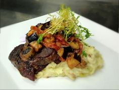 Veal Osso Bucco, veal bacon leek pomme puree, smoked honey carrots, tomato eggplant chutney, trumpet jus.