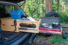The Nomad Kitchen is a handy slide-out car camping kitchen that fits in nearly any hatchback or SUV, yet can take on 200 pounds of weight and 14 gallons of water. Truck Camper, Mini Camper, Camper Trailers, Minivan Camping, Truck Bed Camping, Camping Hammock, Camping Stove, Equipement Camping Car, Astuces Camping-car