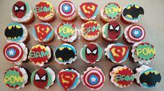 Superhero cupcakes! Spiderman, Superman, Batman, Pow!, Bam!, Captain America. Vanilla cake with a strawberry cream filling and chocolate cake with an Oreo filling.