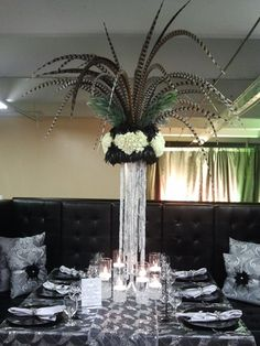Neil Leeson Decor Floral's feathers and flowers table