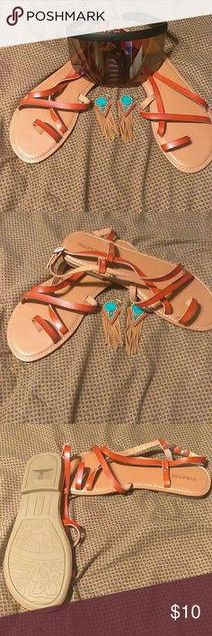 Leather sandals Leather sandals that buckle around the ankle Jewerly and sunglasses not included with the sale Maurice's Shoes Sandals