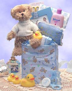 Baby Necessities Gift Bag = This furry tan bear brings the Baby Necessities gift basket. Filled with everything necessary and everything cute for the new baby, it comes in pink for girls, blue for boys, or teal and yellow. Give the gift of total care for the newborn. Give the Baby Necessities gift basket.