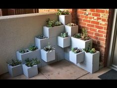 Create your own inexpensive and fully customizable DIY outdoor succulent planter using cinder blocks, landscaping fabric, cactus soil, and succulents