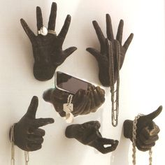 "IShipping is included in the priceIBRBRAll hand wall sculptures hang on two key holes. brbr brbrliDimensions: br(High Five Right) 2.25""w x 2""d x 5.5""hbr(High Five Left) 2.25""w x..."