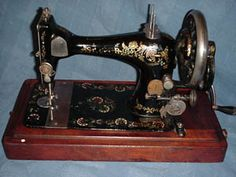 Model V.S. 3 Serial No. 10741452.   This machine dates to 1891 and although worn the 'Peacock Tail' style decals are still beautiful. Again there is no accessory compartment in the base and the patent is stamped on the slide plate. This machine has a double spool attachment.