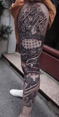 Samurai leg sleeve tattoo.