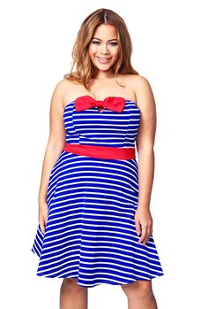 Adorable dress!  Love, love, love the red bow detail.