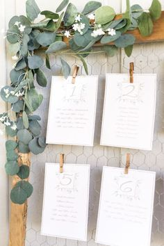Rustic wire clipped wedding escort card display with cascading eucalyptus: http://www.stylemepretty.com/florida-weddings/malabar-florida/2017/02/28/we-should-all-follow-this-brides-simple-wedding-planning-advice/ Photography: Amalie Orrange - http://amalieorrangephotography.com/