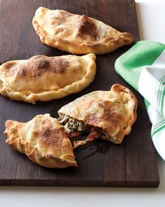 Spinach and Meatball Calzones - Store-bought dough, plenty of fresh spinach, and meatballs and sauce reserved from 30-Minute Spaghetti and Meatballs make this an easy, winning meal.