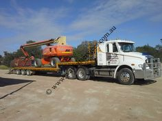The arrival of our 20 Ton 90 Ft high reach boom on a 40 ton low loader Freightliner all the way from Dubbo 180 Kms and 2 hours away from the job site. North Western, Westerns