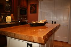 http://heartpine.com/ These homeowners are repeat customers. Two years ago, they visited our showroom and purchased this lovely River-Recovered Heart Cypress Select slab to create this stunning kitchen island.