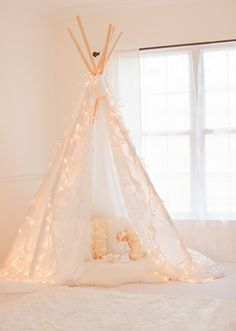 Indoor Tent: Make or buy a pretty teepee tent ($85) for dreamy sleeping.