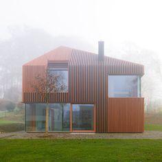 house 11x11. Titus Bernhard Architekten- siding & window placement to balance asymmetrical roof