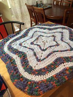 Blanket/ mat in chenille yarn.