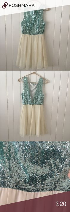 """Arden B. Sequined Homecoming Dress Only worn a couple times. Light teal sequins on top. Measurements provided have been rounded up by quarters, halves, and whole inches.   Measurements:  Chest: 29.5"""" Waist: 24"""" Length: 32 3/4"""" Arden B Dresses Mini"""