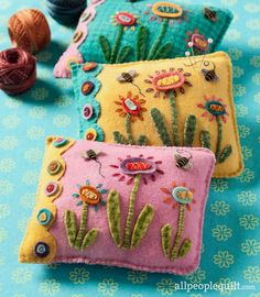 The bees and blooms on these appliquéd and embroidered wool pincushions prove spring has sprung.
