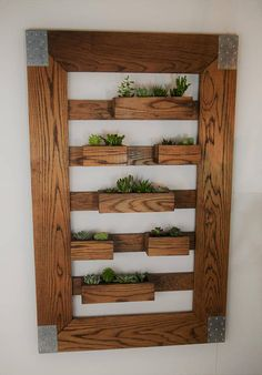 32X50 with 7 flower boxes and no shelf (shown). 60X30 English Chestnut Planter Wall with 7 flower boxes with Shelf 3rd shot). 48X36 Natural Oak with 8 flower boxes with 4 Small Shelves (2ed shot). Boxes are removable and can be re-arranged. 4mm liner is included for each box. Plants are