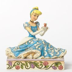 Cinderella with Jaq and Gus                    Cinderella settles in for a cup of tea with her two favorite mice, Jaq and Gus in this highly detailed scultpture designed by Jim Shore for Disney Traditions. Rapunzel, Mulan, Snow White and Belle are also available in this collection too!  Made of stone resin, and stands approximately      5.375in H x 4.5in W x 5.5in L $47.00