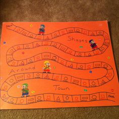Homemade shapes game. I have a special shapes die for this game so they have to match the shape and colors.