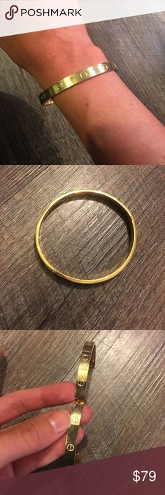LOVE GOLD BRACELET Welcome to my closet! This is a love style bracelet in gold color. Gently worn great condition. Snap closure. My wrist is on the smaller side and this is a little big on me. I have another listing with a set of smaller ones also! Jewelry Bracelets