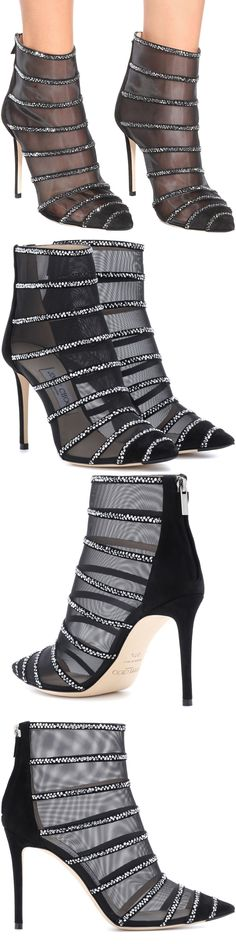 We love the cage-like effect that semi-sheer black mesh lends the Belle 100 ankle boots from Jimmy Choo. Crafted in Italy, this design balances on a slim stiletto heel backed in suede, while sparkling embellishments lend glamour in stripes. #jimmychooheelssuede #jimmychooheelssparkle #stilettoheelsjimmychoo