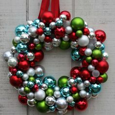 Christmas Ornament Wreath: If mama's looking for an excuse to get new Christmas ornaments this year, here it is! Make a modern and festive Christmas wreath by gluing (with a glue gun) ornaments onto a styrofoam wreath. Tie a colorful ribbon at the top to hang. Source: Matt & Becky
