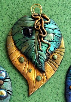 Green amd gold leaf pendant by MandarinMoon, via Flickr