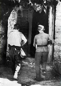 Armed German marines enter a house in southern Greece, where there is an alleged bandit hideout - pin by Paolo Marzioli