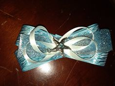 Blue /Aqua color starfish hair bow with alligator clip on Etsy, $6.50