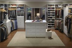 His & hers master bedroom walk-in closet with full centre island