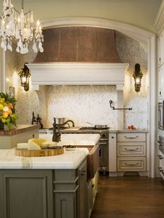 French Country Estate Kitchen... love the copper, bronze, marble and multicolored cabinets