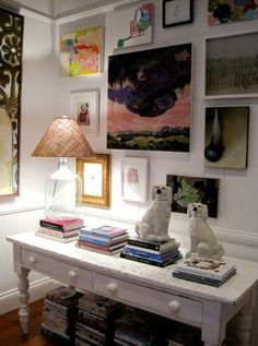 eclectic gallery wall and Staffordshire dogs...lose the boring lampshade, though