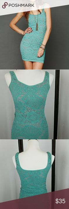 Free People Medallion slip dress This incredibly sexy dress is in excellent used condition. Beautiful teal scalloped lace overlaying an under layer of grey. Free People Dresses Mini
