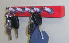 Velas de ignição velhas transformadas em porta chaves