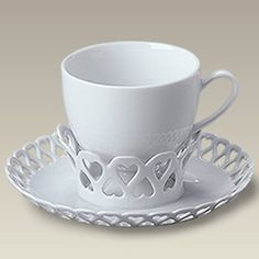 Make your way around the room at your next party without fear of spilling your cup of tea. The raised openwork center of the 6″ wide saucer locks the 6 oz. footed cup in place, ensuring your tea won't spill even if your hand isn't completely steady. The openwork pattern along the rim and center …