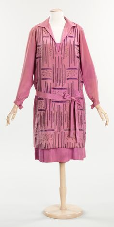 """Day Dress, Goupy: 1926, French, silk, metal. """"Found in this dress is a fairly rare label from an excellent French couture house of the1920s. Making this dress more unique is the fact that it is a day dress, which is not as common to find in costume collections as evening wear, especially from this period. The open collar with V-neck is a classic sportif look from the 1920s and the geometric patterning lends an artistic quality."""""""