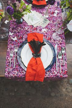Not this color palette at all, but I like the horizontal table runner in a floral print (maybe alternate every other?) with the solid napkin in a complementary color