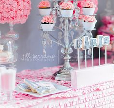 love the cupcake chandelier and the ruffled tablecloth