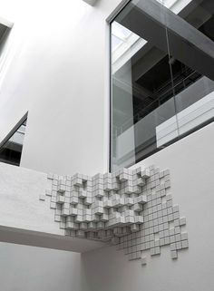 stacked sequence of white 'pixels' cubes grows out from on architectural beams, staircases, and window frames of the lillebælt academy building. by BORGMAN Id Design, Facade Design, Game Design, Lobby Design, Exterior Design, Concept Models Architecture, Architecture Design, Odense Denmark, Modern Art