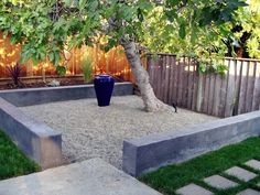 Low bench wall with gravel patio. Keeps · Landscaping Around TreesRiver  Rock LandscapingModern LandscapingLandscaping TipsFront Yard ...