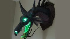 """Mount Disney supervillain Maleficent's head on your wall!:  """"Paper Mache Blog's very own Dragon Expert Dan Reeder has recreated and mounted the head of the beast, and it's beautiful."""""""
