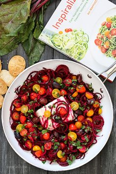 Beet noodles baked with tomatoes, red onion, olives and Feta. Serve this as an appetizer with some baked pita chips, as a side dish or even as a main dish, topped with grilled shrimp or chicken – this dish is a keeper!     I think most of you know I'm pretty obsessed with my spiralizer, (I LOVE my Paderno Spiral VegetableSlicer) but my friend Ali is even more obsessed than me, if that's even possible. So obsessed, she devoted her entire blog to this gadget and just came out with a cookbook…