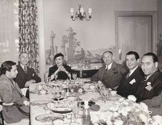 Carole at dinner with the Warner Brothers and a sleepy Mervyn LeRoy