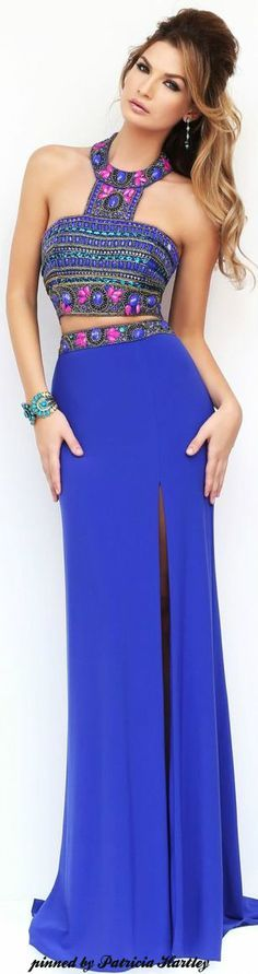 Lightly tanned ombrélette in indigo slit waisted maxi, bejewelled indigo/coral/mint halter crop, turquoise bracelet