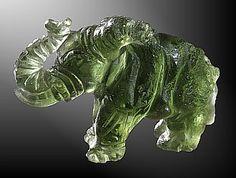Elephant carving, made of Moldavite the green Czech tektite